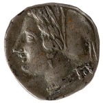 A coin with the face of Aphrodite on the front.